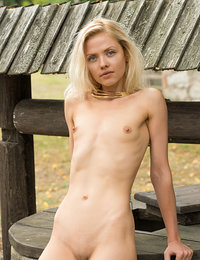 Camelia strips by the well as she bares her petite body.