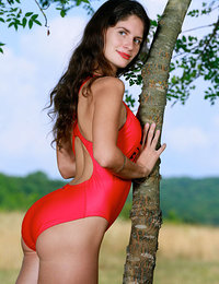 Yasmina strips her sexy red bikini outdoors as she bares her amazing body.