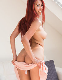 Paula Shy strips by the couch baring her sizzling body and yummy pussy.